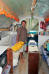 06 April 2011. St Maarten, Antilles, Caribbean.<br /> Crew member David Hildred.<br /> Crew of the Antiki raft arrive in the islands following their epic 9 week trans-Atlantic journey from the Canary islands.  Conditions aboard the very cramped 'Antiki'. The toilet ('room with a view'), shower, emergency raft on the raft! And the cramped living quarters, bunks, radio and satellite equipment, books, cooking facilities, and personal effects.<br /> Crew; Anthony Smith (84 yrs old) British adventurer, John Russell, solicitor and UK resident, David Hildred, sailing master and British Virgin Islands resident,  Dr Andrew Bainbridge of Alberta, Canada.<br /> Photo; Charlie Varley/varleypix.com