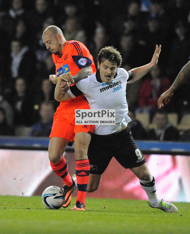 Boltons Alan Hutton Battles with Derbys CHRIS Martin, Derby County v Bolton Wanderers Sky Bet Championship, Pride Park, Tuesday 11th March 2014