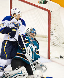 January 6, 2010; San Jose, CA, USA; St. Louis Blues center Andy McDonald (10) knocks San Jose Sharks goalie Evgeni Nabokov (20) to the ice during the second period at HP Pavilion. San Jose defeated St. Louis 2-1 in overtime. Mandatory Credit: Jason O. Watson / US PRESSWIRE