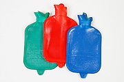 Three hot water bottles on white background