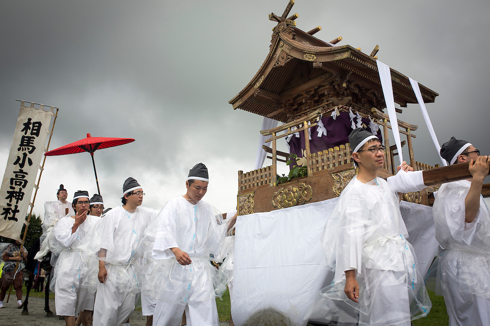 "MINAMISOMA, JAPAN - JULY 24 :  A portable shrine is seen parade during the ""Hon Matsuri"", Soma Nomaoi festival at Hibarigahara field on Sunday, July 24, 2016 in Minamisoma, Fukushima Prefecture, Japan. ""Soma-Nomaoi"" is a three day traditional festival that recreates a samurai battle scene from more than 1,000 years ago. The festival has gathered more than thousands visitors as Fukushima still continues to recovery from the 2011 nuclear disaster, the samurai warriors battles for recovery of the area. (Photo: Richard Atrero de Guzman/NURPhoto)"