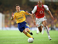 Thierry Henry (Arsenal) Chris Baird (Southampton).  Arsenal v Southampton FA Cup Final 2003 @ Cardiff Arms Park. 17/5/2003. Credit : Colorsport/Andrew Cowie.