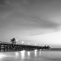San Clemente pier at night black and white photo. San Clemente is a popular beach city in Orange County in Southern California in the United States of America. Copyright ⓒ 2017 Paul Velgos with all rights reserved.