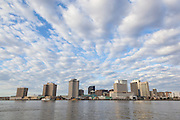Downtown buildings along the Mississippi River in New Orleans including the Hilton Riverside Hotel, International Trade Mart, Aquarium of the Americas, Canal Place, and the New Orleans Marriott Hotel