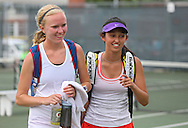 Cedar Rapids Washington's Lilly Hartman (from left) and Rina Moore walk off the court following the finals for the Doubles Draw of the Class 2A state tennis tournament at Veterans Memorial Tennis Center in Cedar Rapids on Friday, May 31, 2013.