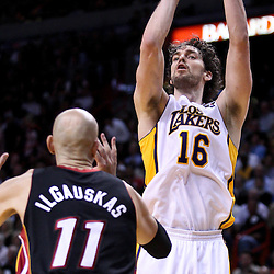 March 10, 2011; Miami, FL, USA; Los Angeles Lakers power forward Pau Gasol (16) shoots over Miami Heat center Zydrunas Ilgauskas (11) during the second quarter at the American Airlines Arena.  Mandatory Credit: Derick E. Hingle