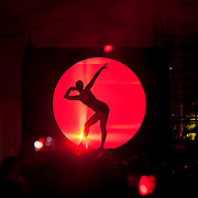 May 17, 2013 - Queens, NY :  A dancer is projected in silhouette at the Neon Garden stage during the first day of the 2013 New York 'Electric Daisy Carnival,' an electronic dance music festival, at Citi Field in Queens, on Friday. CREDIT: Karsten Moran for The New York Times CREDIT: Karsten Moran for The New York Times