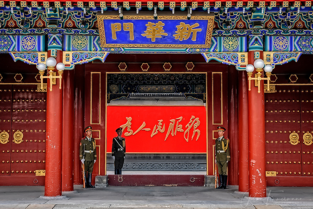 Guards outside the Xinhua gate in central Beijing.