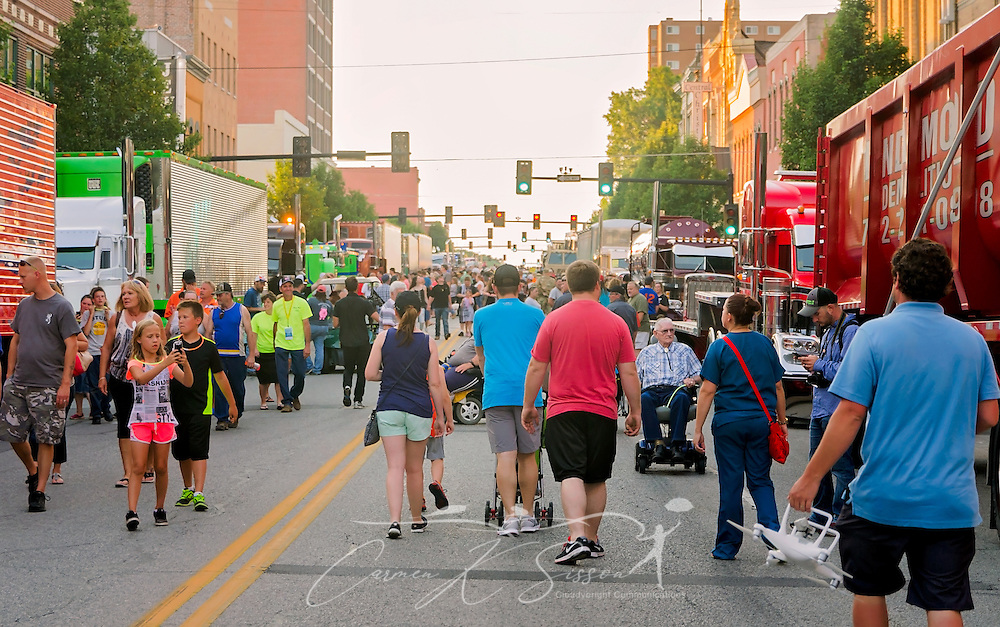 A crowd of people inspects big rigs on Main Street during the 34th annual Shell Rotella SuperRigs parade to begin, June 10, 2016, in Joplin, Missouri. SuperRigs, organized by Shell Oil Company, is an annual beauty contest for working trucks. Approximately 89 trucks entered this year's competition. (Photo by Carmen K. Sisson/Cloudybright)