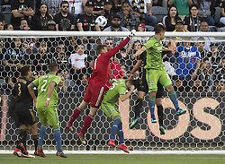 April 29, 2018 - Los Angeles, California, U.S - 29 April 2018, Los Angeles, Ca.,The Los Angeles Football Club (LAFC) beat the Seattle Sounders in the inaugural game at the new Banc of California Stadium. Pictured is LAFC's Goal Keeper Tyler Miller deflecting the ball. (Credit Image: © Prensa Internacional via ZUMA Wire)