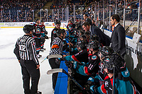 KELOWNA, CANADA - DECEMBER 1: Nolan Foote #29 of the Kelowna Rockets stands on the ice as head coach Adam Foote speaks to referees from the bench against the Saskatoon Blades  on December 1, 2018 at Prospera Place in Kelowna, British Columbia, Canada.  (Photo by Marissa Baecker/Shoot the Breeze)