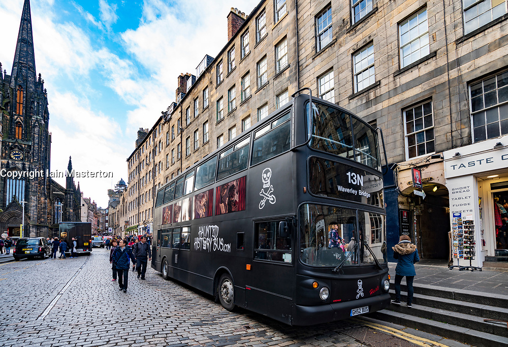 Tourist ghost tour bus parked on the Royal Mile in Edinburgh Old Town, Scotland, UK.