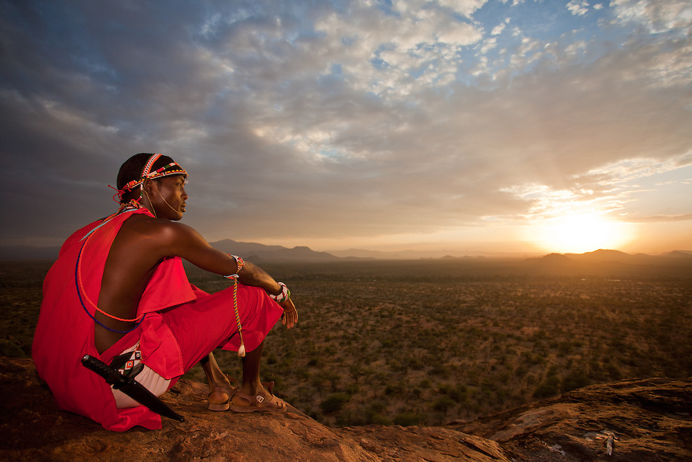 A Samburu Moran surveys a vast landscape unscarred by industrial development in northern Kenya