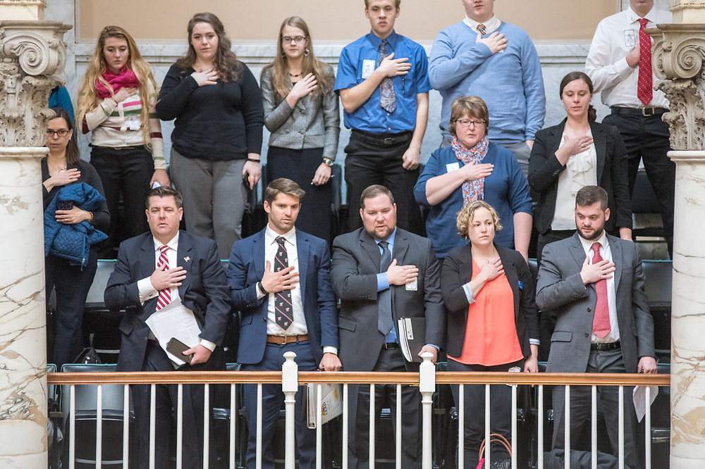 Group of people stand up for the national anthem inside the Maryland State House, Annapolis, Maryland