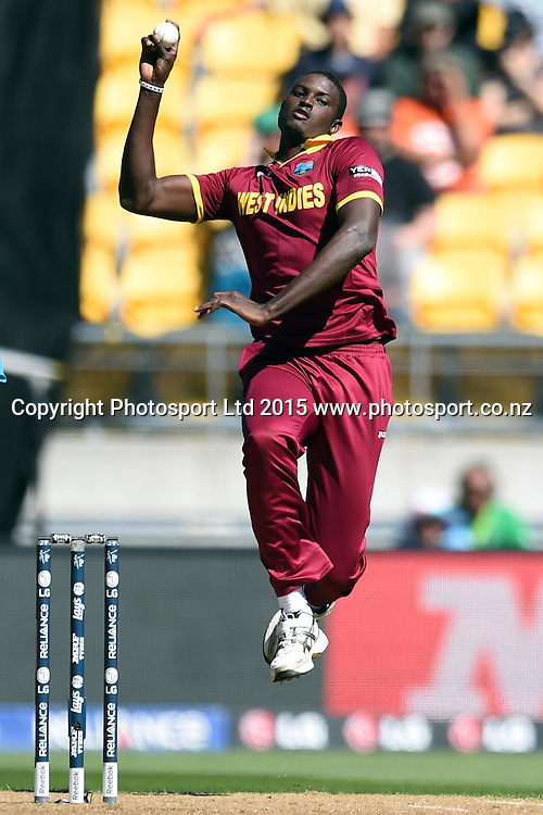 West Indies captain Jason Holder into his delivery stride during the ICC Cricket World Cup Quaterfinal match between New Zealand and West Indies at Westpac Stadium in Wellington, New Zealand. Saturday 21  March 2015. Copyright Photo: Raghavan Venugopal / www.photosport.co.nz
