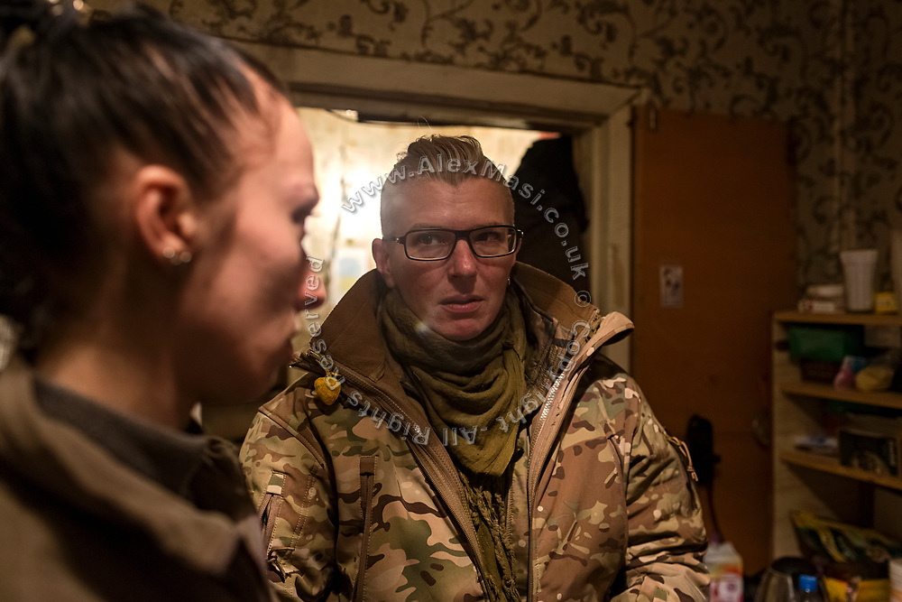 Julia Paevska (right) is talking with Elena Mosiychuk, (nom the guerre Maliok, or 'Baby') another member of ASAP, while standing in an improvised 'warehouse' for medicines, set up in an abandoned home in the village of Klynove, near the frontline in eastern Ukraine.
