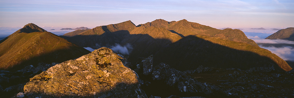 Early morning light bathes the tops of Buchaille Etive Beag and the Glencoe Massif in the backbround.