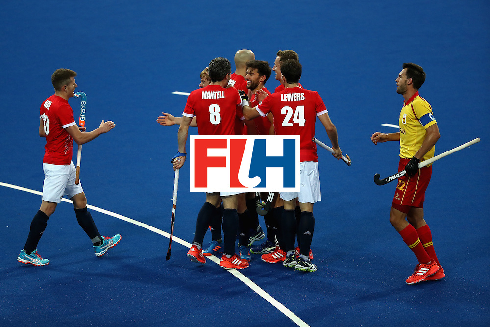 RIO DE JANEIRO, BRAZIL - AUGUST 12:  Manel Terraza #22 of Spain walks past after Iain Lewers #24, Simon Mantell #8, and Sam Ward #13 of Great Britain after scored  during a Men's Preliminary Pool B match on Day 7 of the Rio 2016 Olympic Games at the Olympic Hockey Centre on August 12, 2016 in Rio de Janeiro, Brazil.  (Photo by Sean M. Haffey/Getty Images)