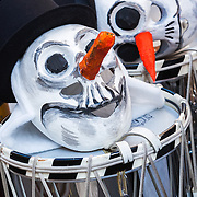 Masks of skeleton snowmen resting on some drums on a break during carnival (fastnacht) in Basel, Switzerland.