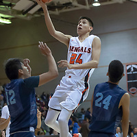 Quinn Atazhoon (24) of Gallup soars to the rim as defenders Adrian Desta (12) and Marian Ynzuna (24) of Window Rock watch during the Gallup Invitational Tournament game in Gallup. Gallup won 64-42.