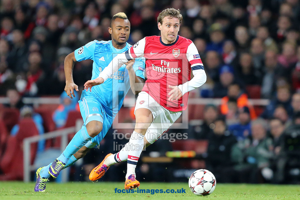 Picture by Richard Calver/Focus Images Ltd +447792 981244<br /> 26/11/2013<br /> Nacho Monreal of Arsenal and Jordan Ayew of Olympique de Marseille during the UEFA Champions League match at the Emirates Stadium, London.