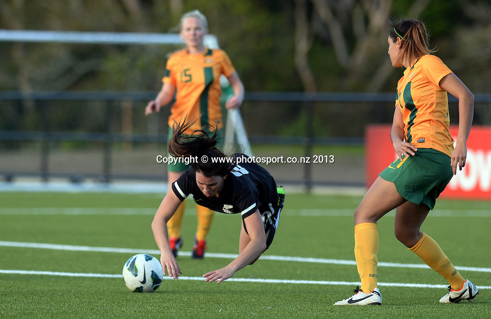 Emma Rolston goes down after colliding with Australia's Chloe Logarzo. New Zealand Junior Football Ferns v Australia Young Matildas. Women's U20 International. Match 3. Seddon Fields, Auckland. Monday 29 July 2013. Photo: Andrew Cornaga/www.Photosport.co.nz