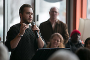 Rowan Collins, Education Coordinator at the Gay Alliance of Rochester, speaks at a rally at Spot Coffee, organized by Rochester Circle for Peace, in Rochester on Sunday, January 8, 2017.