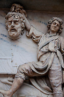 Milan, Italy, Duomo Cathedral - relief stone sculpture of David carrying Goliath's head in triumph.