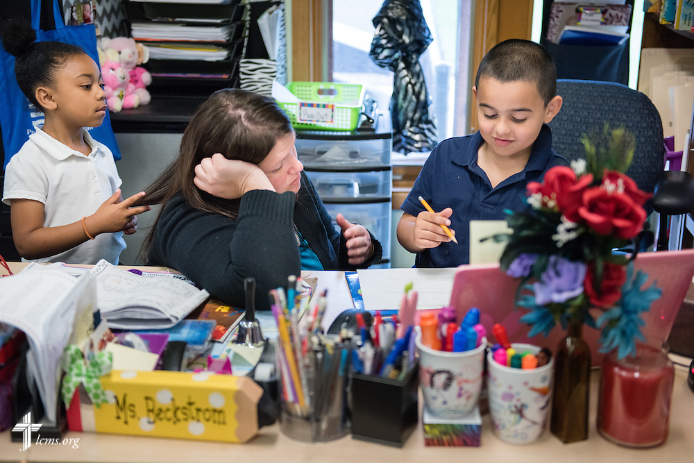 Kindergarten teacher Lindsay Beckstrom works with a student in her class at the Renaissance School, part of Lutheran Urban Mission Initiative, Inc., on Wednesday, May 20, 2015, in Mt. Pleasant, Wis. LCMS Communications/Erik M. Lunsford