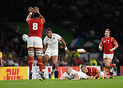 England wing Anthony Watson puts a kick just over Wales back row Taulupe Faletau and runs to the try line during the Rugby World Cup Pool A match between England and Wales at Twickenham, Richmond, United Kingdom on 26 September 2015. Photo by David Charbit.