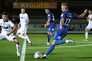 AFC Wimbledon midfielder Mitchell (Mitch) Pinnock (11) with a shot on goal during the EFL Trophy group stage match between AFC Wimbledon and U21 Swansea City at the Cherry Red Records Stadium, Kingston, England on 18 September 2018.
