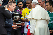 Pope Francis poses with team players of the Clericus Cup at the end of his weekly general audience in Saint Peter's square on May 23, 2018 in Vatican.