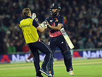 Cricket - 2017 West Indies Tour of England - Fourth One Day International (ODI): England vs. West Indies<br /> <br /> England's Moeen Ali has his gloves changed after they went one run ahead under the 'Duckworth  Lewis ' rule at The Oval.<br /> <br /> COLORSPORT/ANDREW COWIE