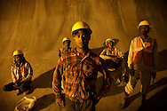 Workers take break inside tunnel at Punatsangchhu-I Hydroelectric Project in Bhutan on September 4, 2013. The project, which will have a capacity of 1200 MW, is the first of a series of 10 hydropower projects jointly identified by India &amp; Bhutan and to be implemented for a total installed capacity of 11,576 MW by 2020.<br /> (Photo by Kuni Takahashi)