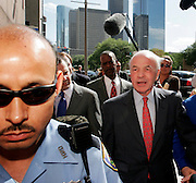 Former Enron chairman Kenneth Lay (L) leaves the Bob Casey U.S. Courthouse following proceedings in his fraud and conspiracy trial, May 16, 2006, in Houston. The defense presented it's closing arguments in the trial that has spanned 16 weeks. (Photo by Dave Einsel)