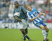 Photo: Aidan Ellis.<br /> Wigan Athletic v Newcastle United. The Barclays Premiership. 15/10/2005.<br /> Wigan's Jimmy Bullard keeps a close eye on the ball as Newcastle's Charles N'Zogbia looks on