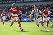 Middlesbrough forward Christian Stuani (18)  watches closely by West Bromwich Albion defender Jonny Evans (6)  during the Premier League match between West Bromwich Albion and Middlesbrough at The Hawthorns, West Bromwich, England on 28 August 2016. Photo by Simon Davies.