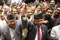 June 3, 2017 - Kathmandu, Nepal - Nepali Congress President Sher Bahadur Deuba (left) along with the outgoing Prime Minister Pushpa Kamal Dahal among other senior leaders applaud after filing Deuba's nomination for the post of Prime Minister scheduled for tomorrow at the Legislature Parliament in Kathmandu, Nepal on Saturday, June 03, 2017. (Credit Image: © Skanda Gautam via ZUMA Wire)