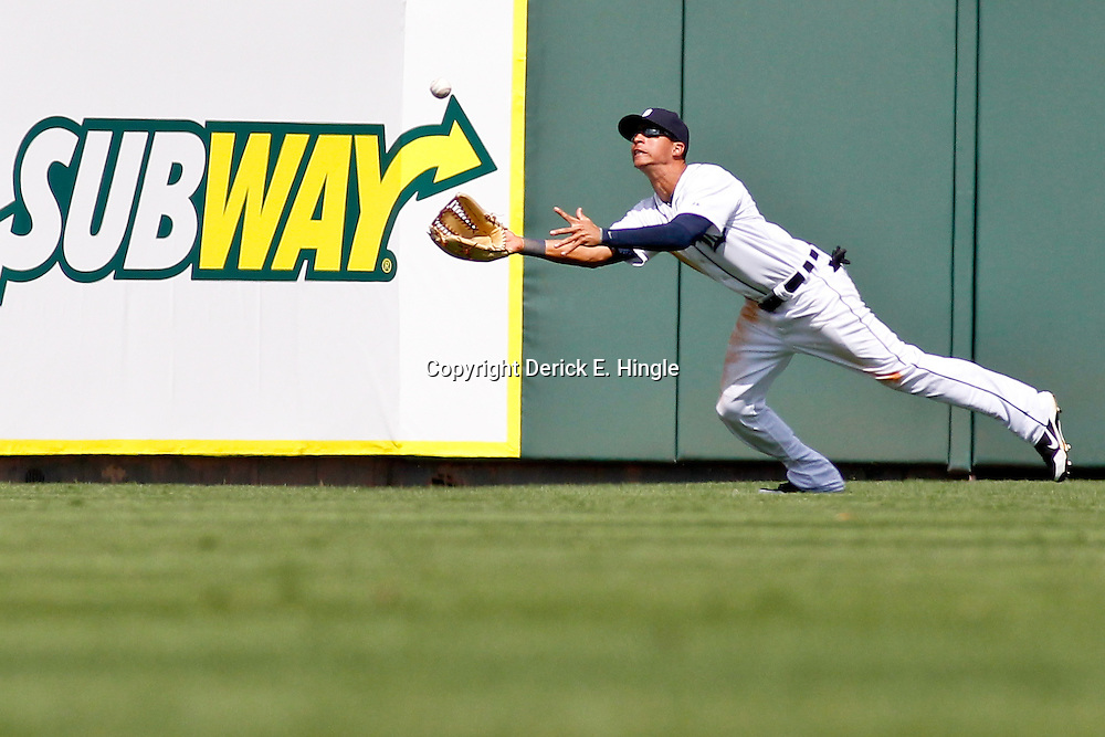 March 14, 2012; Lakeland, FL, USA; Detroit Tigers center fielder Quintin Berry (66) dives but is unable to come up with the ball resulting in a New York Mets second baseman Jordany Valdespin (not pictured) one run double during the top of the sixth inning of a spring training game at Joker Marchant Stadium. Mandatory Credit: Derick E. Hingle-US PRESSWIRE