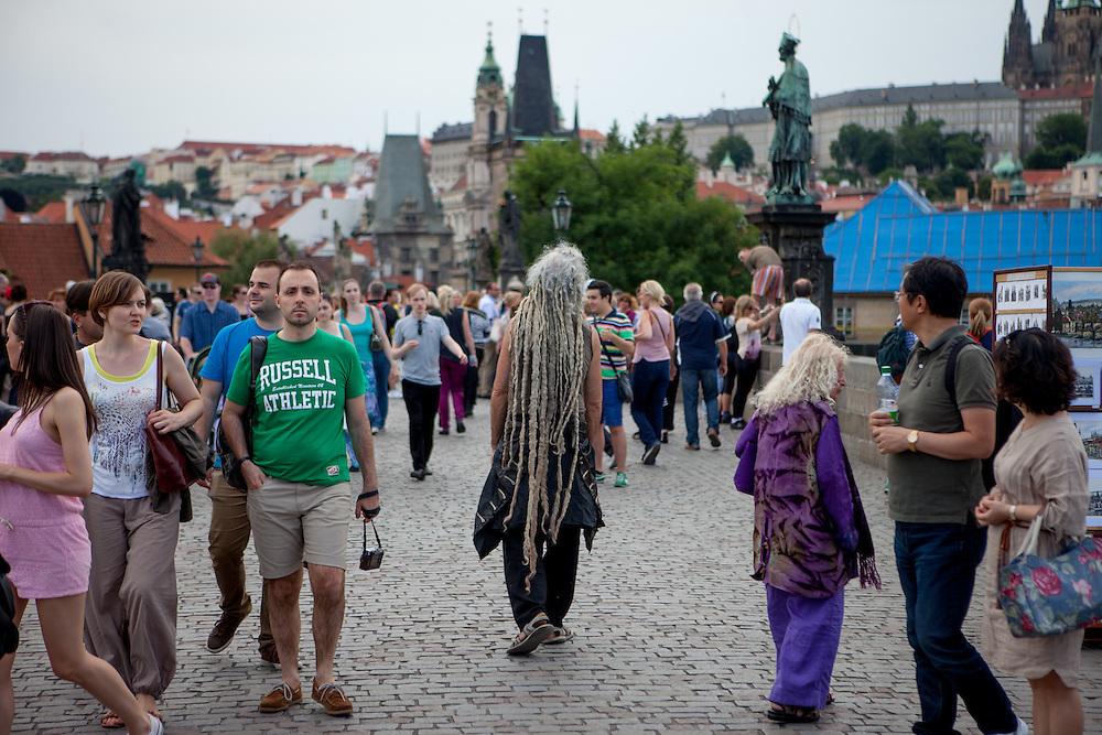A Prague visitor with dreadlocks at Charles Bridge.