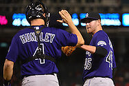 Apr 29, 2016; Phoenix, AZ, USA; Colorado Rockies relief pitcher Scott Oberg (45) is congratulated by catcher Nick Hundley (4) after closing out the game against the Arizona Diamondbacks at Chase Field.  The Colorado Rockies won 9-0. Mandatory Credit: Jennifer Stewart-USA TODAY Sports