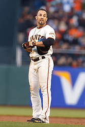 May 24, 2011; San Francisco, CA, USA;  San Francisco Giants center fielder Andres Torres (56) reacts after getting tagged out at first base against the Florida Marlins during the third inning at AT&T Park. Florida defeated San Francisco 5-1.