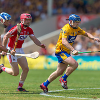 Clare's Podge Collins gets away from Cork's Daniel Kearney and Sean O'Donoghue