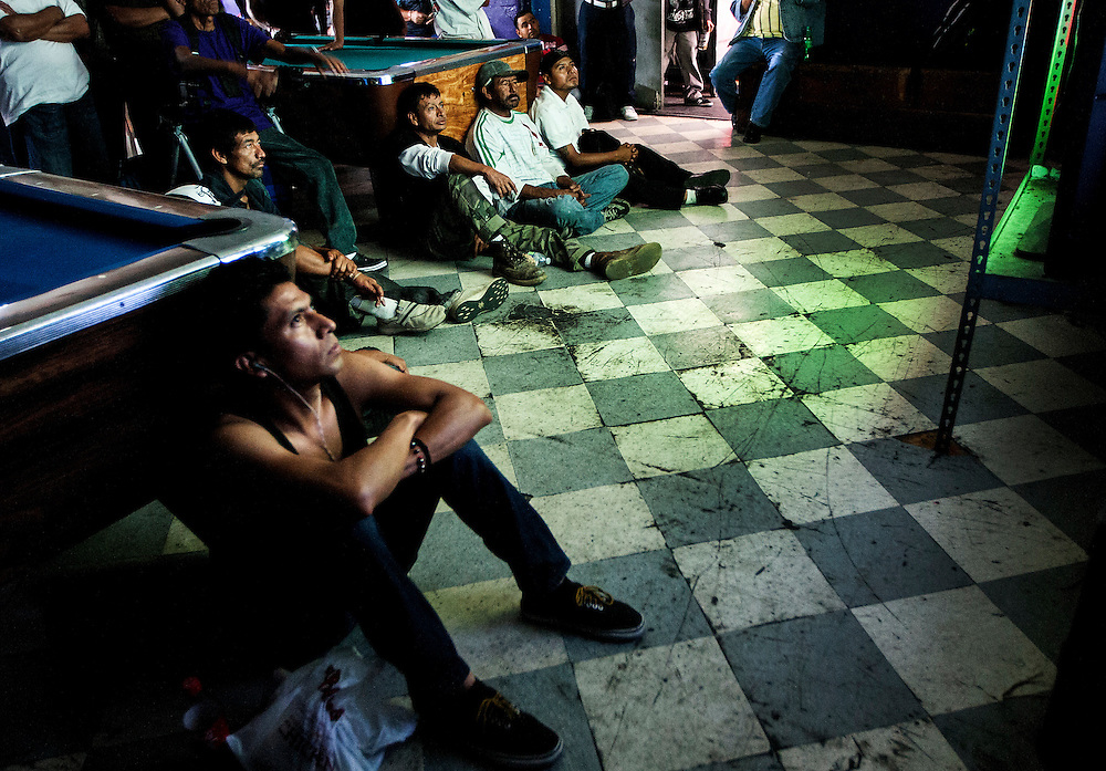 Fans of the Mexican national soccer team watch in the back half of Sassony Arcade as Mexico takes on Brazil during a World Cup Group A match on Tuesday, June 17, 2014 in downtown Los Angeles. Mexico and Brazil finished in a 0-0 tie. (Photo by Michael Yanow)