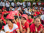 01 NOVEMBER 2015 - YANGON, MYANMAR:  Women listen to Aung San Suu Kyi at the NLD's last election rally of the 2015 election in the Yangon suburbs Sunday. Political parties are wrapping up their campaigns in Myanmar (Burma). National elections are scheduled for Sunday Nov. 8. The two principal parties are the National League for Democracy (NLD), the party of democracy icon and Nobel Peace Prize winner Aung San Suu Kyi, and the ruling Union Solidarity and Development Party (USDP), led by incumbent President Thein Sein. There are more than 30 parties campaigning for national and local offices.   PHOTO BY JACK KURTZ