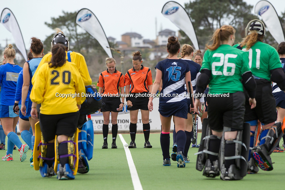 Umpires Amber Church and Kelly Hudson lead the teams out for the Auckland v Northern Women`s Final match, Ford National Hockey League, North Harbour Hockey Stadium, Auckland, New Zealand,Sunday, September 14, 2014. Photo: David Rowland/Photosport
