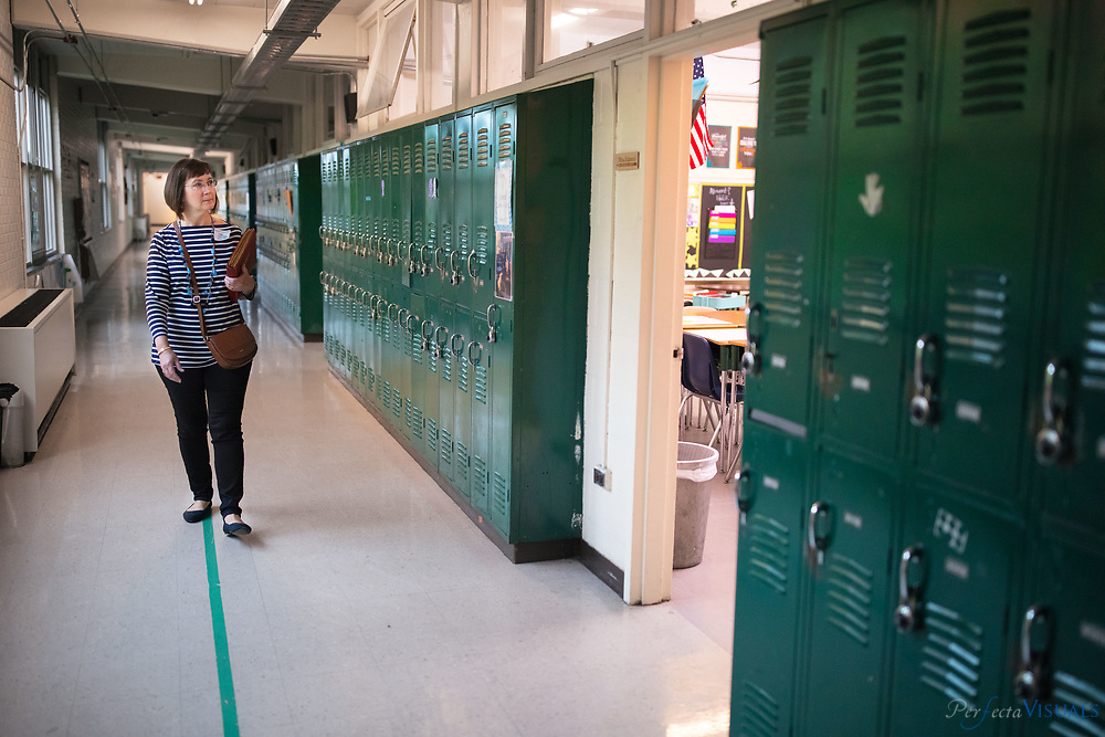 Joyce Nethery Kemmerer walks though the school.<br /> <br /> At least 50 alumni and two former teachers came together Saturday to celebrate the 60th anniversary of Kiser Middle School. The Kiser Alumni Association put together the celebrate to honor the school's recent accomplishments, its illustrious past and its newest milestone. Named after former mayor and school board chairman, Claude Kiser, the school turned 60 this year.<br /> <br /> Photographed, Saturday, October 28, 2017, in Greensboro, N.C. JERRY WOLFORD  / Perfecta Visuals