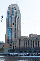 Minneapolis, MN - January 26, 2017: Bold North Zip Line participants zoom down the line and over the Mississippi River as part of the SuperBowl LII events taking place in Minneapolis.
