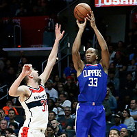 09 December 2017: LA Clippers forward Wesley Johnson (33) takes a jump shot over Washington Wizards guard Tomas Satoransky (31) during the LA Clippers 113-112 victory over the Washington Wizards, at the Staples Center, Los Angeles, California, USA.