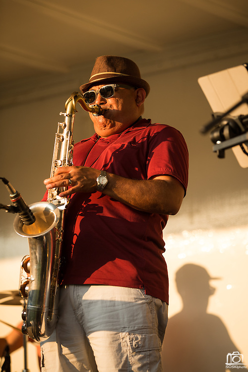 Big Blu Soul Revue saxophonist Hermann Lara performs as guests enjoy heat and music during the City of Milpitas Summer Concert Series at Murphy Park in Milpitas, California, on July 26, 2016. (Stan Olszewski/SOSKIphoto)